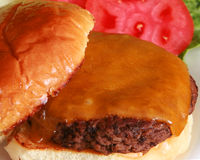 Close up of a cheeseburger Royalty Free Stock Images