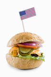 Close up of cheeseburger with American flag Royalty Free Stock Photos
