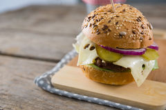 Close up of cheeseburger. On cutting board Royalty Free Stock Image