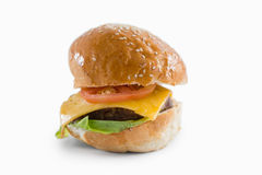 Close up of cheeseburger with sesame seeds Royalty Free Stock Images