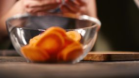 Close up of a chef carefully cutting some carrots stock video