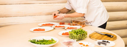 Close-up of chef cooking food kitchen restaurant cutting cook hands hotel man male knife preparation fresh preparing Royalty Free Stock Image