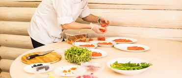 Close-up of chef cooking food kitchen restaurant cutting cook hands hotel man male knife preparation fresh preparing Royalty Free Stock Photos