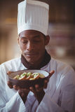 Close-up of chef with eyes closed smelling food Royalty Free Stock Photos