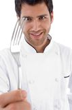 Close up of chef holding fork Stock Image