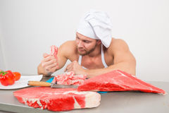 Close-up of chef in a nightcap with huge pieces of Royalty Free Stock Photos
