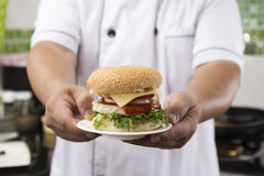Close up Chef presented Hamburger Stock Images
