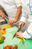Close up of chefs cutting vegetables Stock Photography