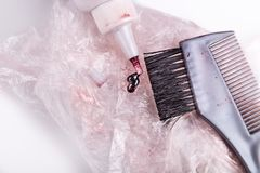 Close-up of chemical hair color dye set with comb brush. Close-up of chemical hair color dye set with comb and brush Royalty Free Stock Photography