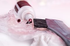 Close-up of chemical hair color dye set with comb brush. Close-up of chemical hair color dye set with comb and brush Royalty Free Stock Photo