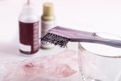 Close-up of chemical hair color dye set with comb brush. Close-up of chemical hair color dye set with comb and brush Royalty Free Stock Image