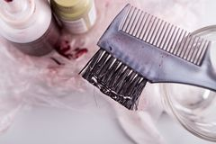 Close-up of chemical hair color dye set with comb brush. Close-up of chemical hair color dye set with comb and brush Stock Photography
