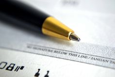 Close up on cheque with a pen Stock Photos