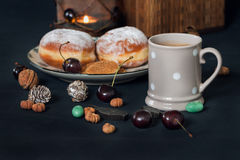 Close up of cherries, cookies and a candle. Stock Images