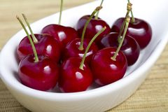 Close up cherries in white bowl Stock Images
