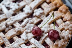 Close up cherry pie with and ripe two cherry royalty free stock images
