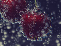 Close up cherry in pure water with bubbles Stock Photo