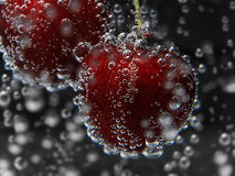 Close up cherry in pure water with bubbles Stock Photography