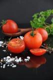Close up Cherry Tomato on Black Background Stock Photos