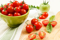 Close up of Cherry Tomatoes with Basil Royalty Free Stock Image