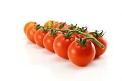 Close Up of cherry tomatoes on the vine. In white background royalty free stock photos