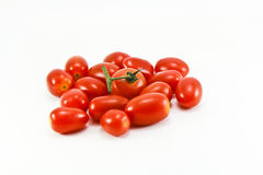 Close Up of cherry tomatoes on the vine. In white background stock photo