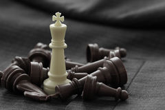 close up of chess figure on suit background strategy or leadersh Stock Photo