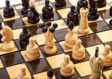 Close up of chess pieces on a board during a game Stock Images