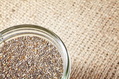 Close up of Chia seeds in a jar on linen background. Stock Photo