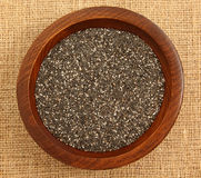 Close Up Of Chia Seeds In Wooden Bowl Stock Photos