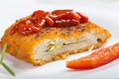 Chicken cordon Bleu on plate with tomato sauce or ketchup Royalty Free Stock Image