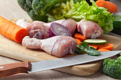 Close-up of chicken drumsticks with  vegetables Stock Image