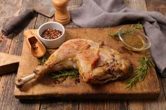Chicken leg on board. Close up on chicken leg on board Royalty Free Stock Photography