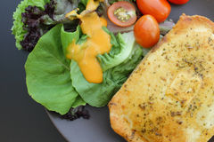 Close-up of chicken pie with salad Royalty Free Stock Photo