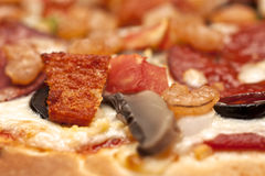 Close up of a Chicken and Prawn pizza Stock Images