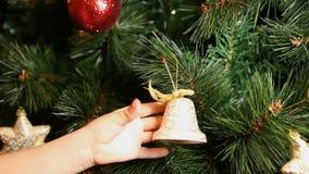 Child hanging decoration on christmas tree stock video