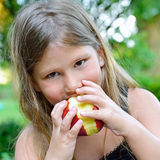 Close up of a Child eating a red apple Royalty Free Stock Images