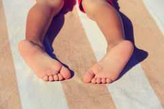 Close up of child feet on beach towel Royalty Free Stock Images