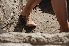 Close up of child feet in the sand Royalty Free Stock Photos