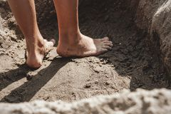 Close up of child feet in the sand Royalty Free Stock Image