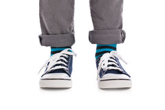 Close-up on child feet with sneakers Royalty Free Stock Image