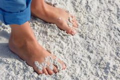 Close up of child feet on a tropical sandy beach Stock Photography