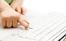 Close up of child finger pressing key on laptop Stock Image