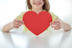 Close up of child hands holding red heart Stock Images