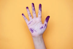 Close up of child hands painted with watercolors stock photo