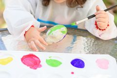 Little Child Drawing On Stone Outdoors On Summer Sunny Day. royalty free stock photo
