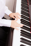 Close up of child hands playing the piano Stock Images