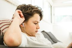 Close-up of a child with headphones at home stock photos