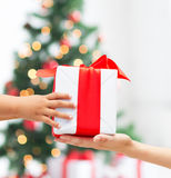 Close up of child and mother hands with gift box Stock Photography