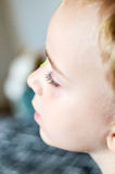 Close up of child`s eyelash. And eyepatch for a correction of the vision of the other eye stock image